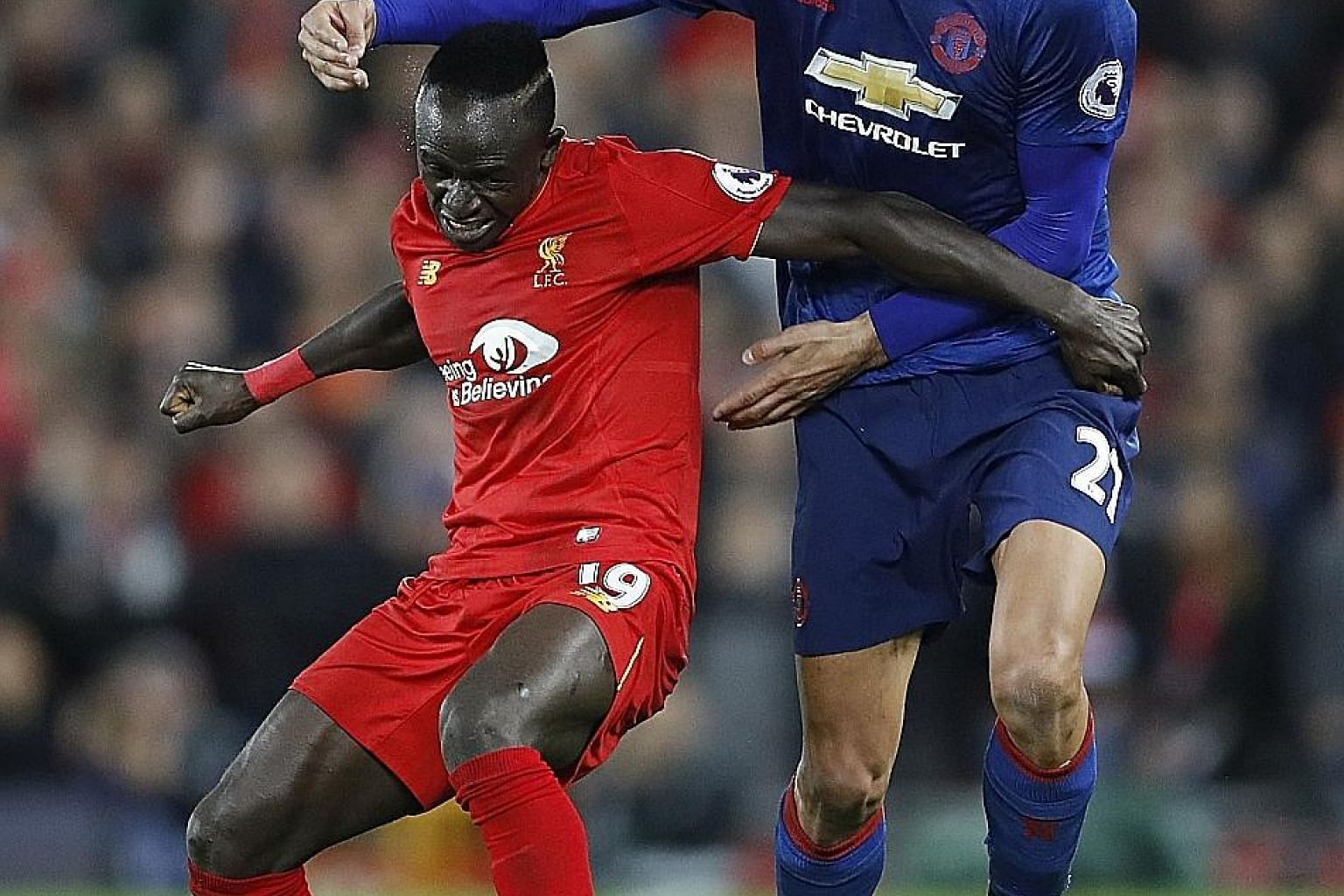 Manchester United's Marouane Fellaini trying to shake his much shorter Liverpool opponent Sadio Mane off the ball in the 0-0 draw on Monday. After their first clean sheet in the league this season, Jurgen Klopp would want his side to keep it tight at