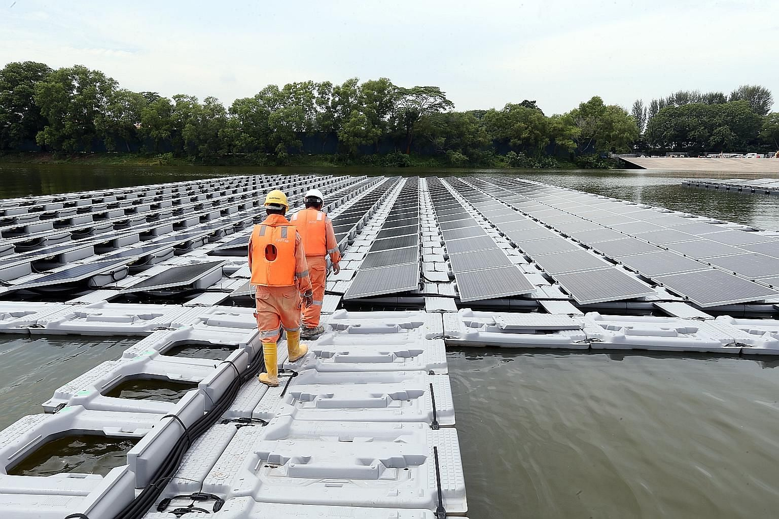 The floating solar photovoltaic cell test bed is an amalgam of 10 different systems. Each system, consisting of solar cells that can convert sunlight directly into energy, has a peak capacity of 100 kilowatts, enough to power 30 four-room HDB flats f