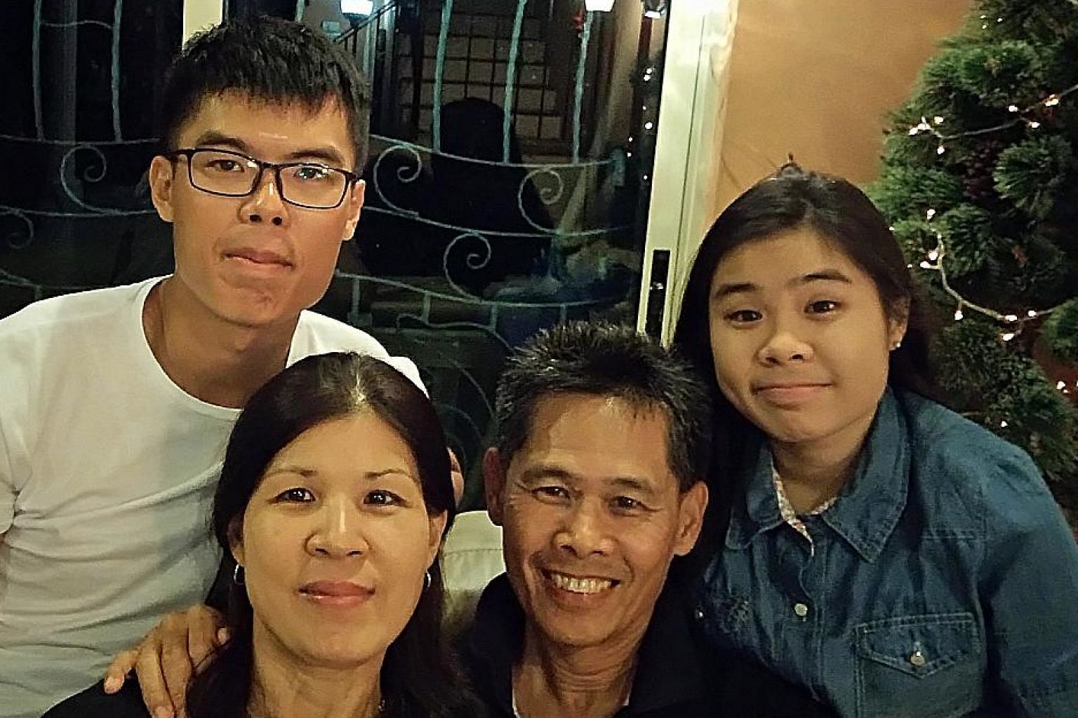 Mr Ho with his wife Susan, son Jonathan and younger daughter Christabel. He enjoys staying abreast of events that affect Singapore and the environment.