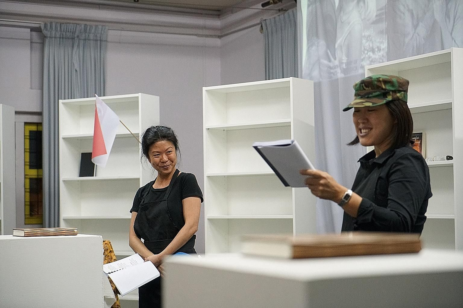 Jean Ng (left) and Serene Chen read extracts from academic journals, book reviews and news reports about writers, publishers and the books industry in Rant And Rave II.