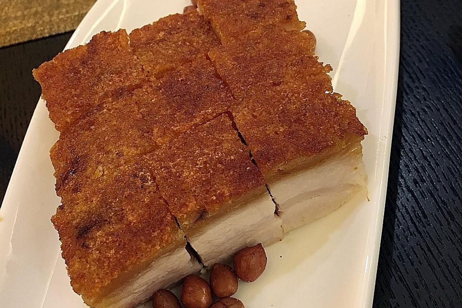 The Golden Crispy BBQ Pork Belly (above) has a delightfully crispy crackling; and the Chengdu Oil Boiled Fatty Beef is tongue- numbingly spicy and aromatic.
