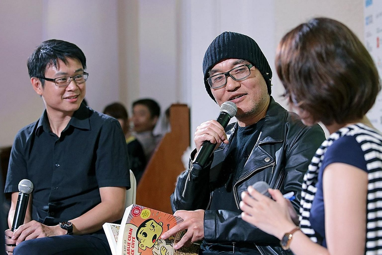 Gosho Aoyama (centre) with Singapore artist Sonny Liew at the talk on Sunday.