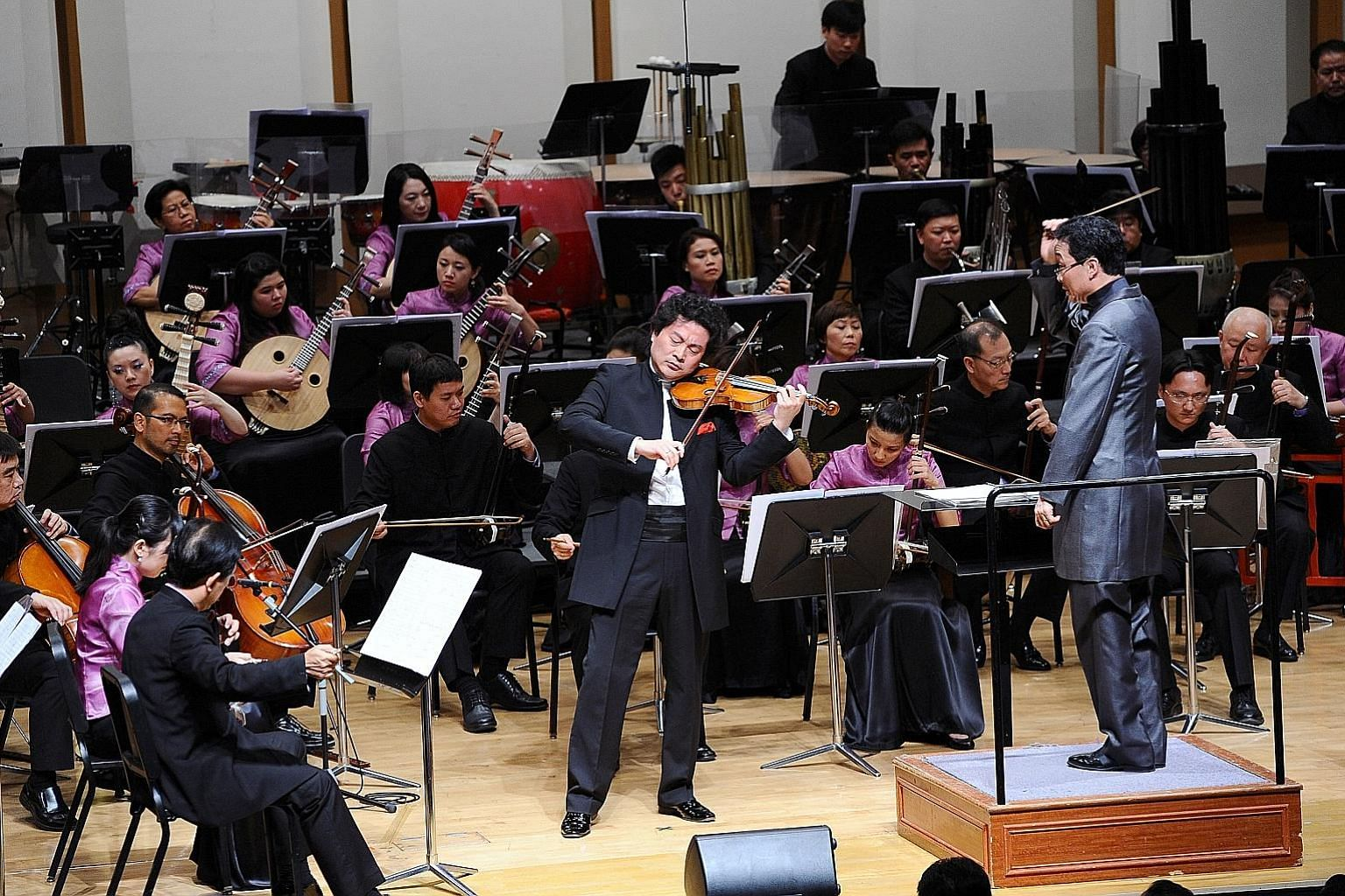 Violin virtuoso Lu Siqing with the Singapore Chinese Orchestra. The SCO concert Strings Fantasy will be the world's first Chinese orchestra concert to be digitally broadcast online.