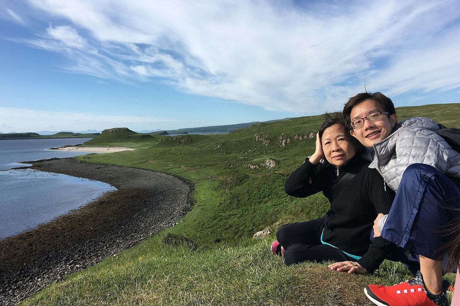 Mr Ng with his mother, Madam Ang Gek Hong, in Scotland. One of his passions is exploring new places on foot.