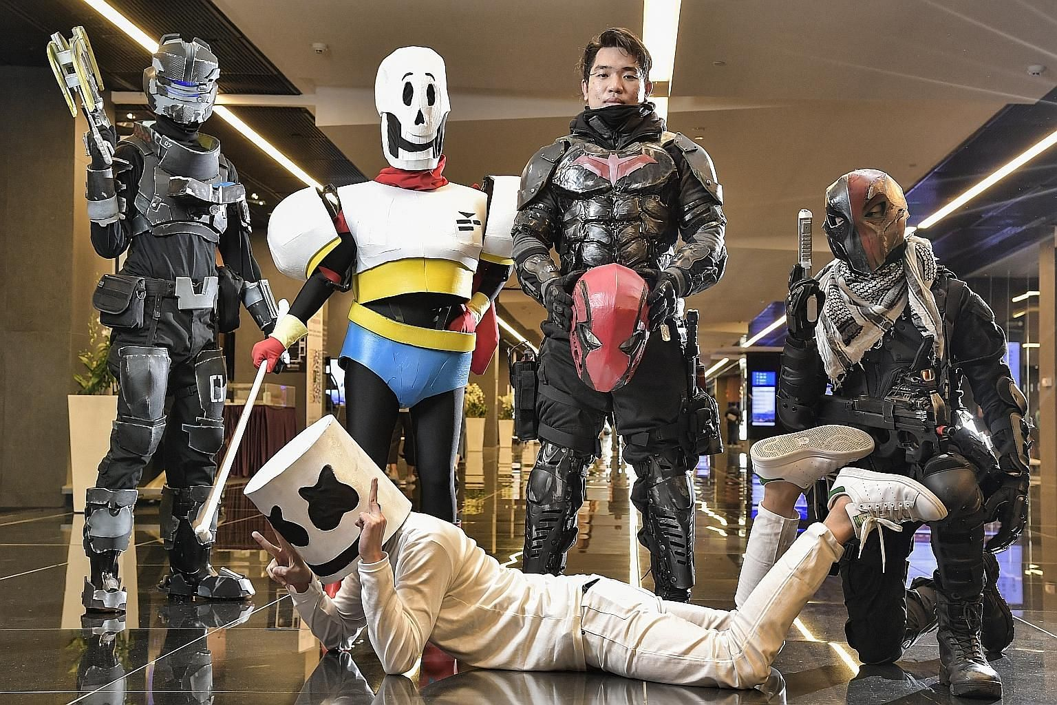 "The cosplayers head home, after having ""transformed"" back into their usual selves, lugging their costumes and props with them, after attending the GameStart 2016 convention at the Suntec Singapore Convention and Exhibition Centre in October. Mr Yip,"