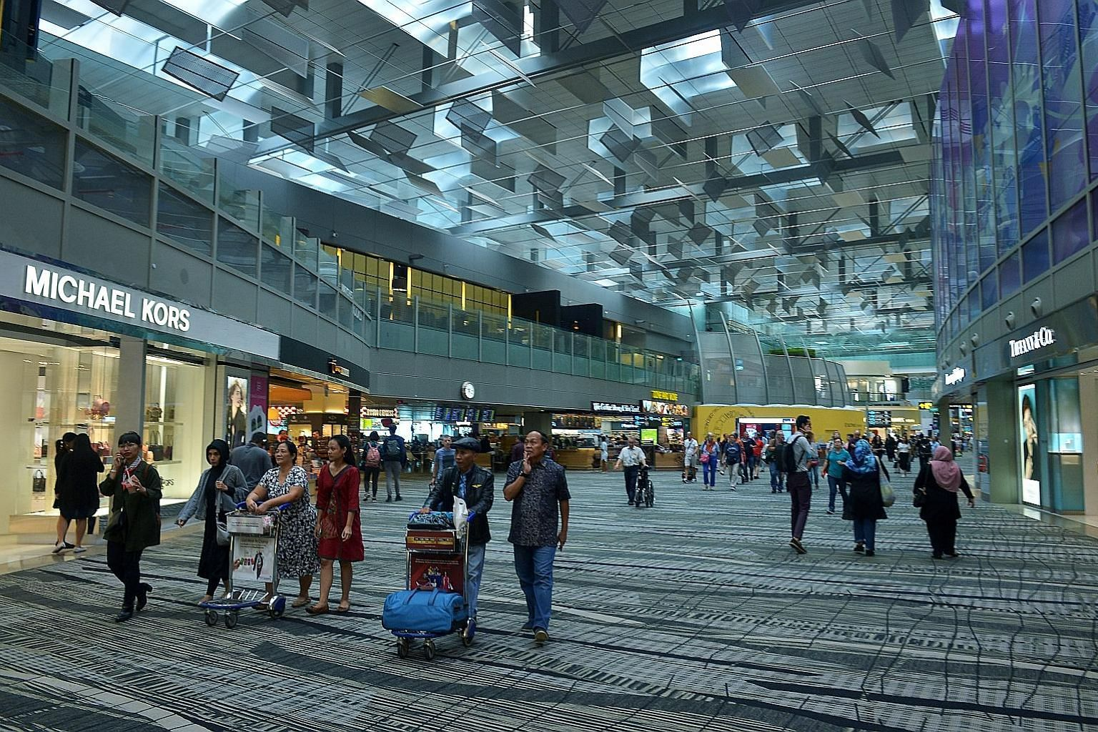 Passengers in transit at Changi Airport Terminal 3. With increasing awareness of the need for travel insurance, regular travellers are opting for annual policies.