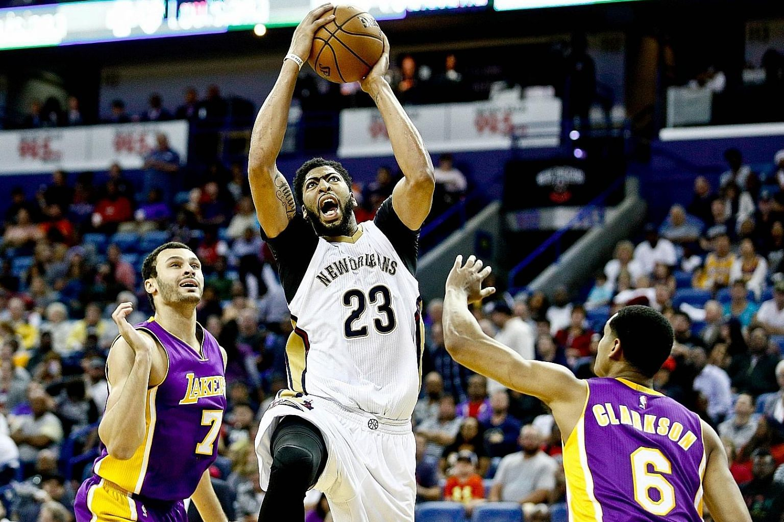 Pelicans' Anthony Davis drives between Lakers' Larry Nance Jr. and Jordan Clarkson at the Smoothie King Centre. Davis, the NBA's leading scorer, has finished with at least 35 points and 10 rebounds seven times this season.