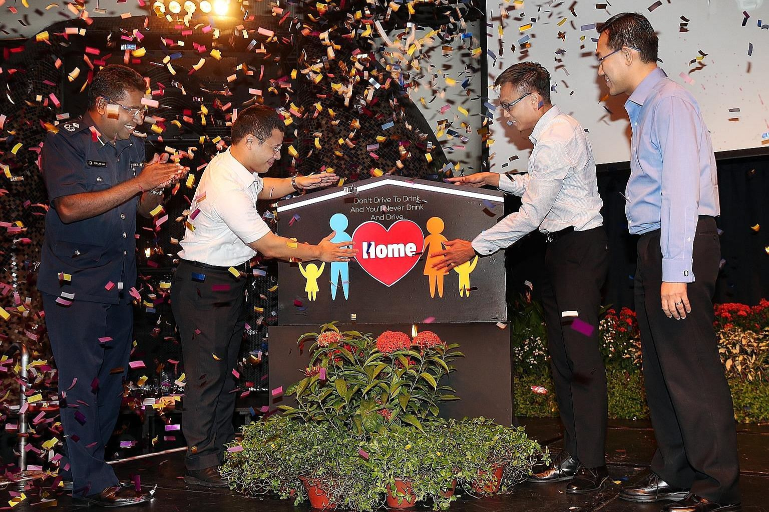 From left: Deputy commander of the Traffic Police and assistant commissioner of police Devrajan Bala, Senior Minister of State Desmond Lee, executive director of the Singapore Road Safety Council, Mr Chua Chee Wai, and executive vice-president of the