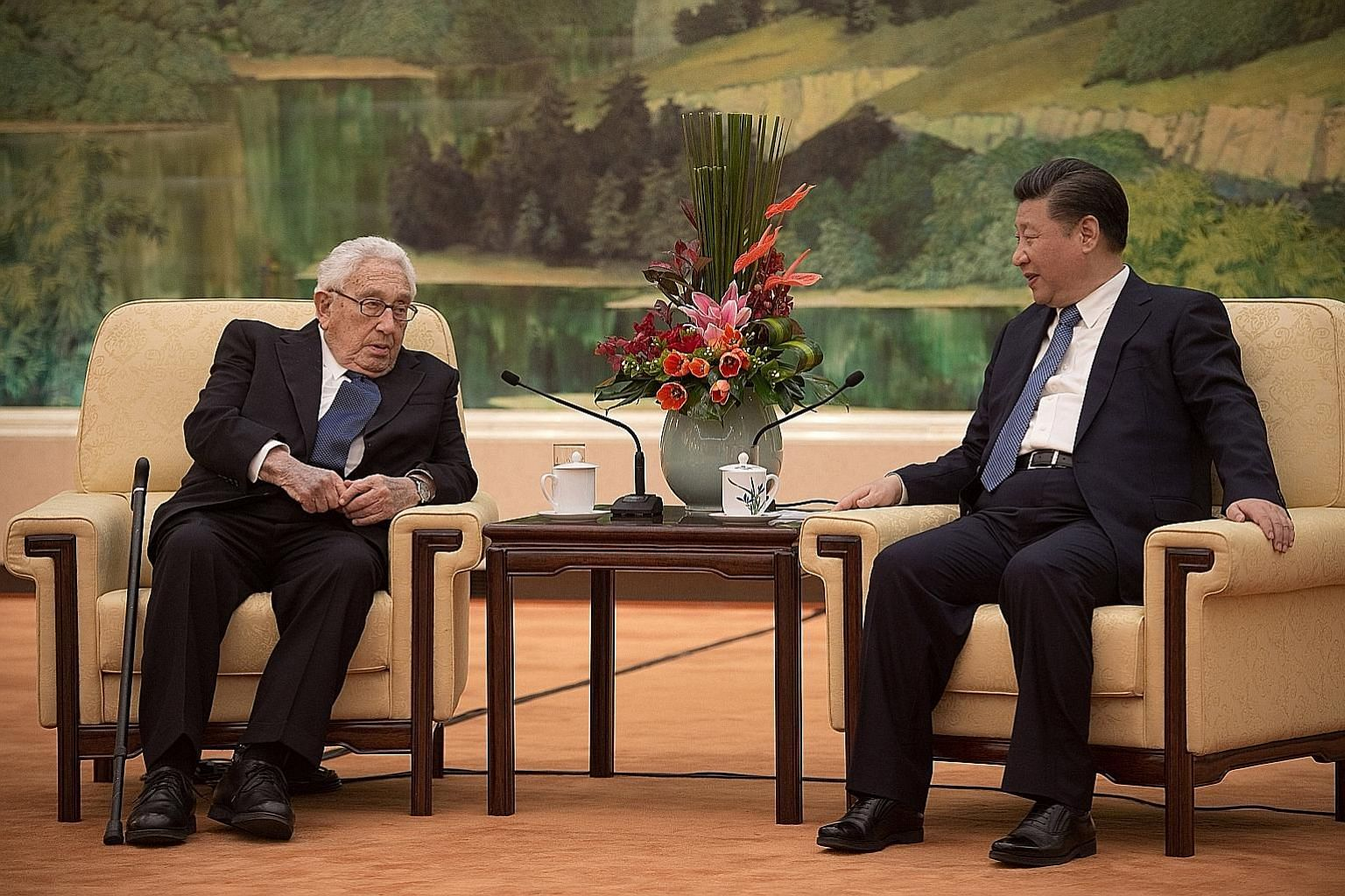 "Dr Kissinger with President Xi in the Great Hall of the People in Beijing yesterday. Mr Xi told the former US secretary of state that ""I am all ears to what you have to say"" about the future of US-China relations."