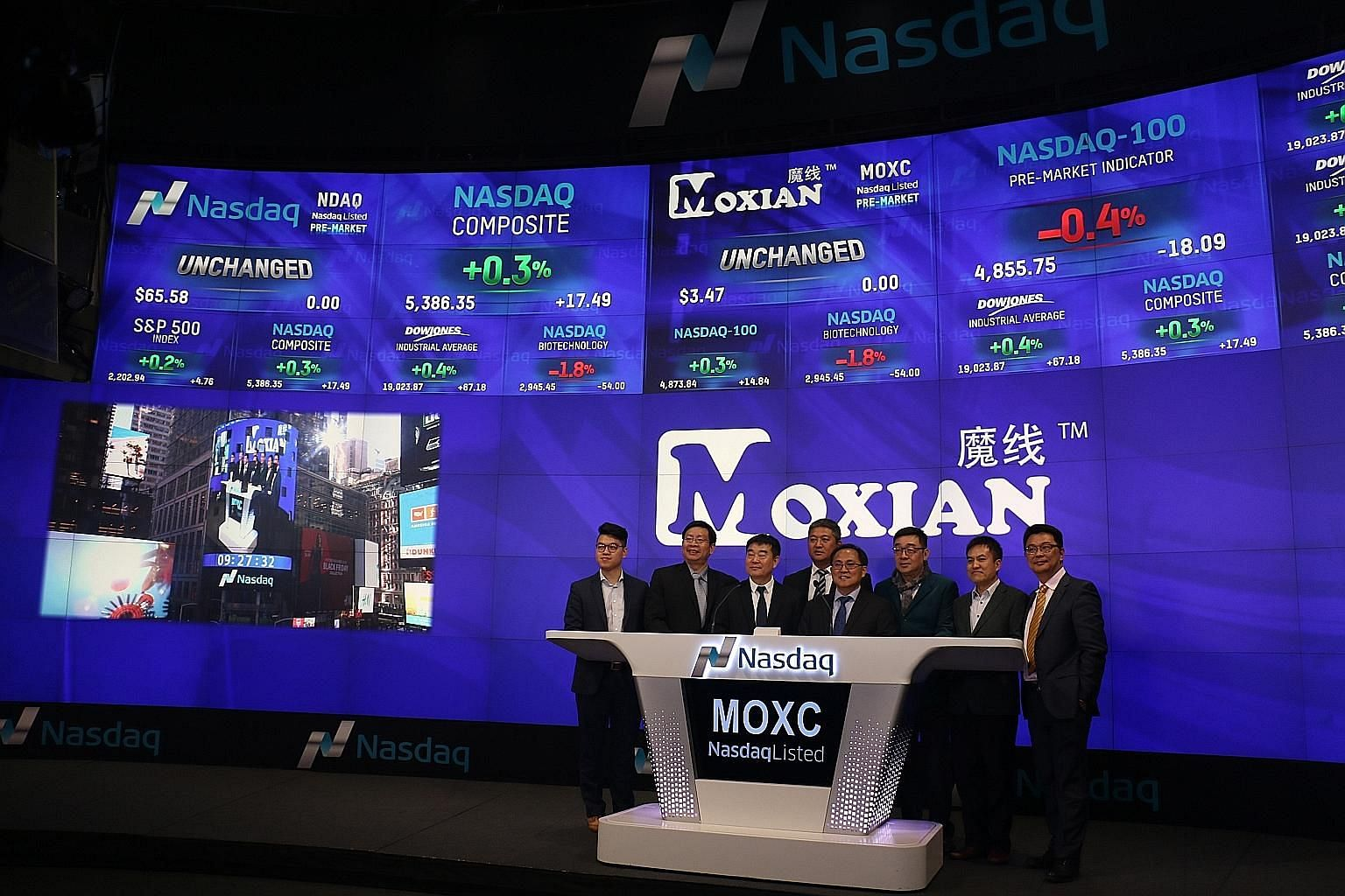 Moxian chief executive James Tan (fifth from left) in New York for the tech company's Nasdaq listing ceremony.