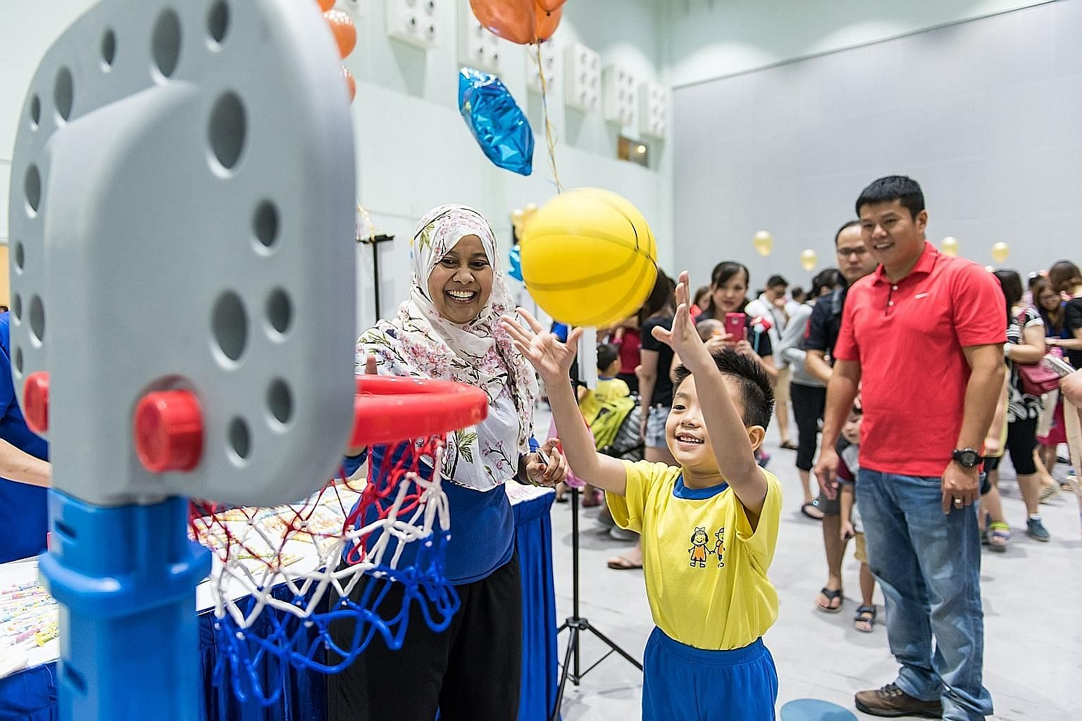A Star Learners' childcare centre pupil playing at the centre's charity fun fair in July. The event raised $15,000 for The Straits Times School Pocket Money Fund.