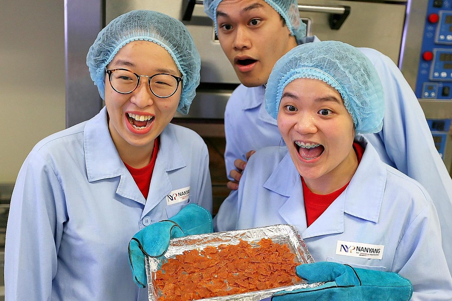 The four-member NYP team, which includes (from left) Ms Lai, Mr Muhammad Haziq and Ms Peh, incorporated okara, a soya bean residue, together with chicken to make their bak kwa and baked it to a crisp.