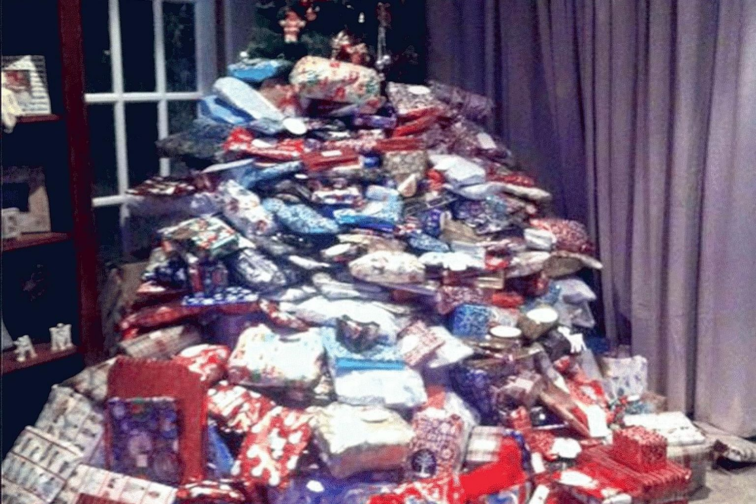 Ms Emma Tapping, whose picture of a mountain of Christmas gifts went viral last year, has shared an image of an even bigger pile this year.