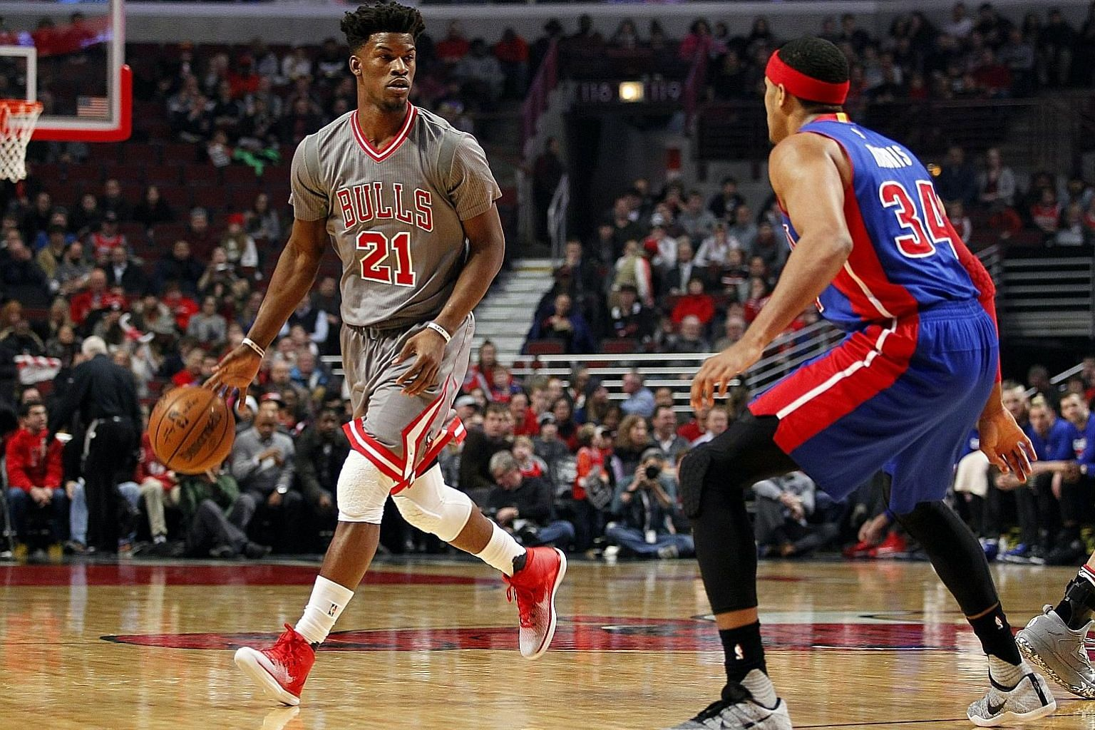 Chicago forward Jimmy Butler looking to pass to a team-mate while Detroit forward Tobias Harris guards him during their NBA game at United Centre. Detroit crashed to their third straight loss in a 113-82 thrashing.