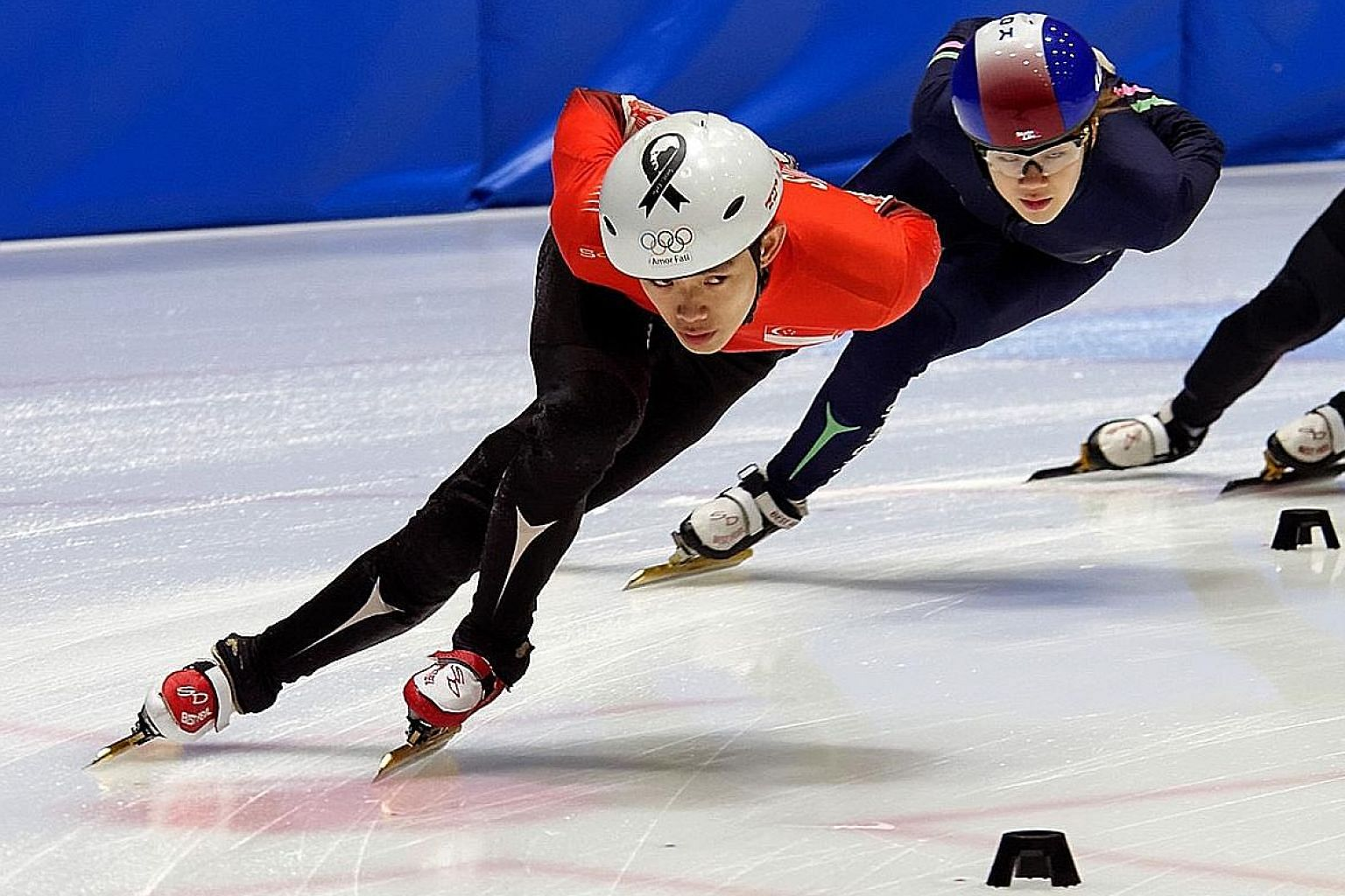 Lucas Ng (front) training in Goyang with elite-level Korean skaters, such as 2014 Winter Olympics gold medallist Kong Sang Jeong (back).