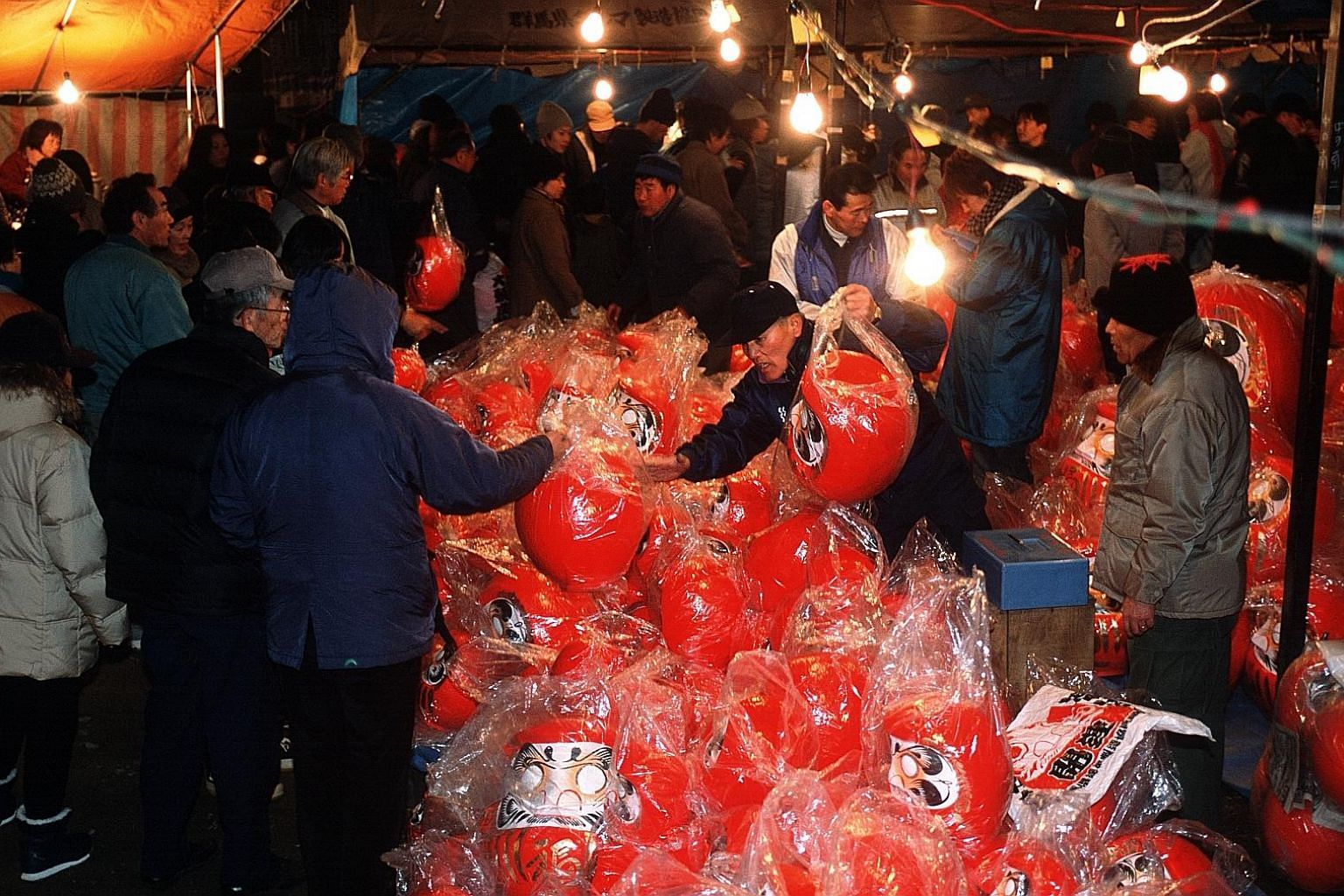 More than 300,000 people visit Shorinzan Daruma Temple in Takasaki, Japan, during the Daruma festival on Jan 6 and 7 to buy the round dolls for good luck in the new year.
