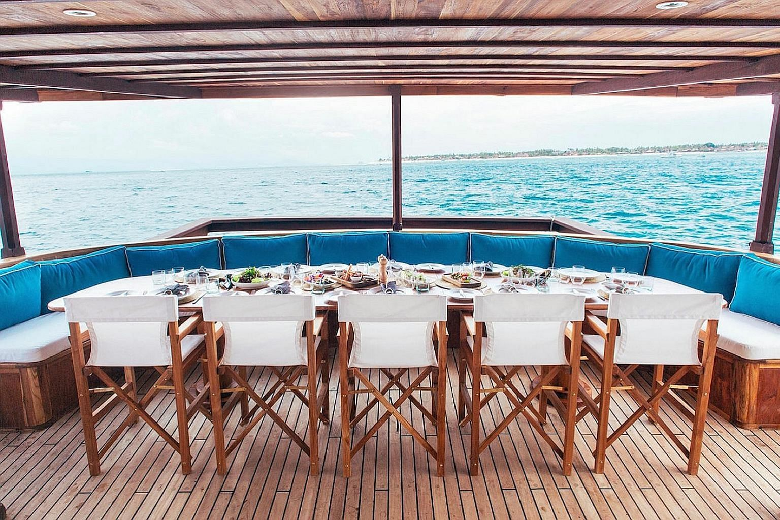 Stay at Ashford Castle, the former residence of the famous Guinness family, on Trafalgar's 10-day Iconic Ireland tour starting on April 23. Dine al fresco aboard Rascal, a traditional phinisi superyacht based in Indonesia available for private charte