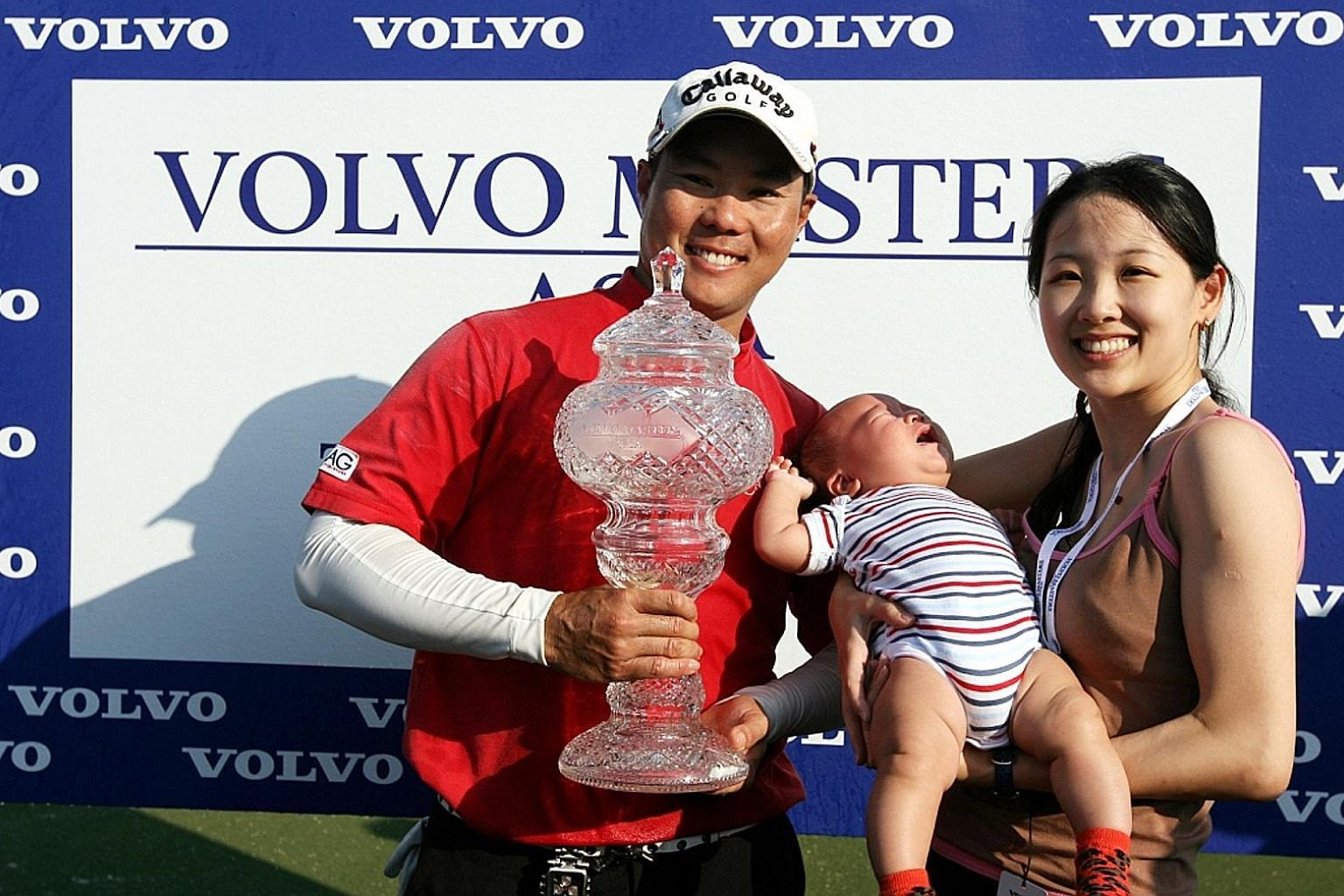 Lam Chih Bing with wife Sophie and son Tian Lei, after winning his first, and only, Asian Tour title - the Volvo Masters of Asia - in Bangkok in December 2008.