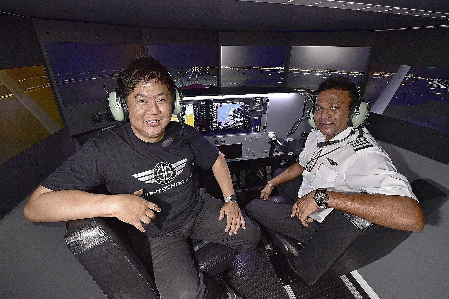 Members of Singapore Youth Flying Club on a navigation trip to Malacca. Mr Fabian Lim (far left), co-founder of FlightSchool. sg, which uses a flight simulator to conduct flight training. He is with Captain Saravanan Sukomaran, an instructor at the s
