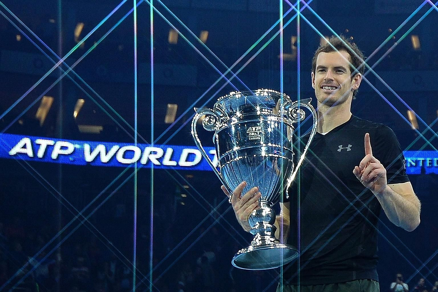 Top: Britain's Andy Murray posing with the ATP World Number One trophy after finishing as the year-end world No. 1 at the season-ending ATP World Tour Finals in London last month. Above: Women's tennis world No. 1 Angelique Kerber of Germany posing a