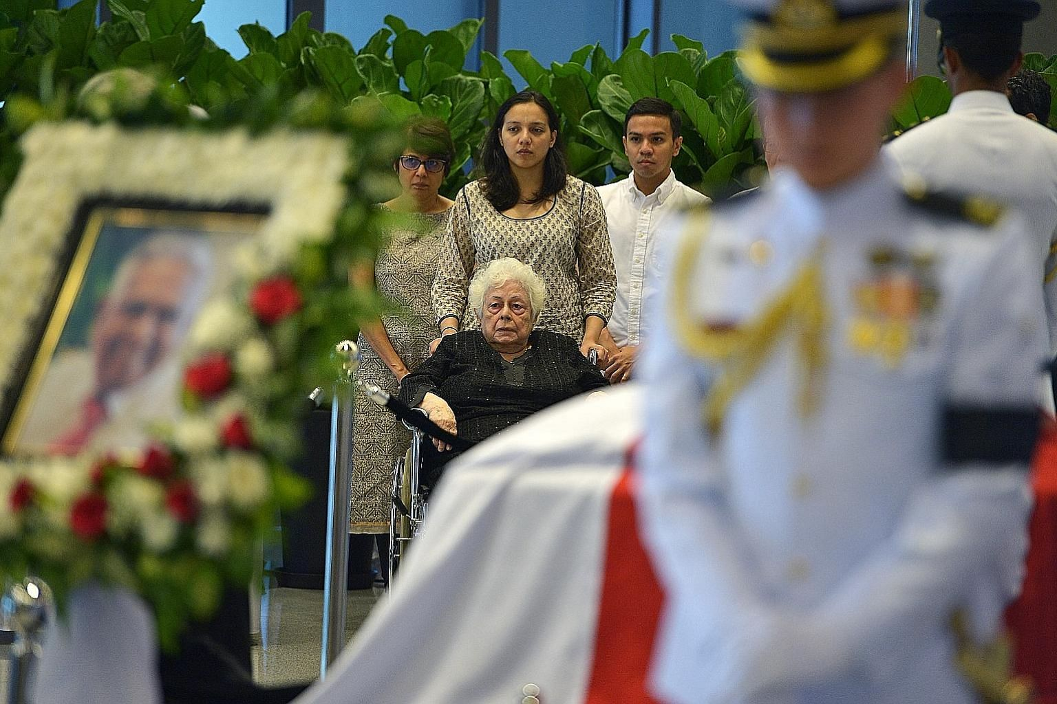 Madam Urmilla Umi Nandey (in wheelchair), wife of former president Nathan, with her children at Parliament House on Aug 25, three days after his death. Mr Nathan died at the age 92.