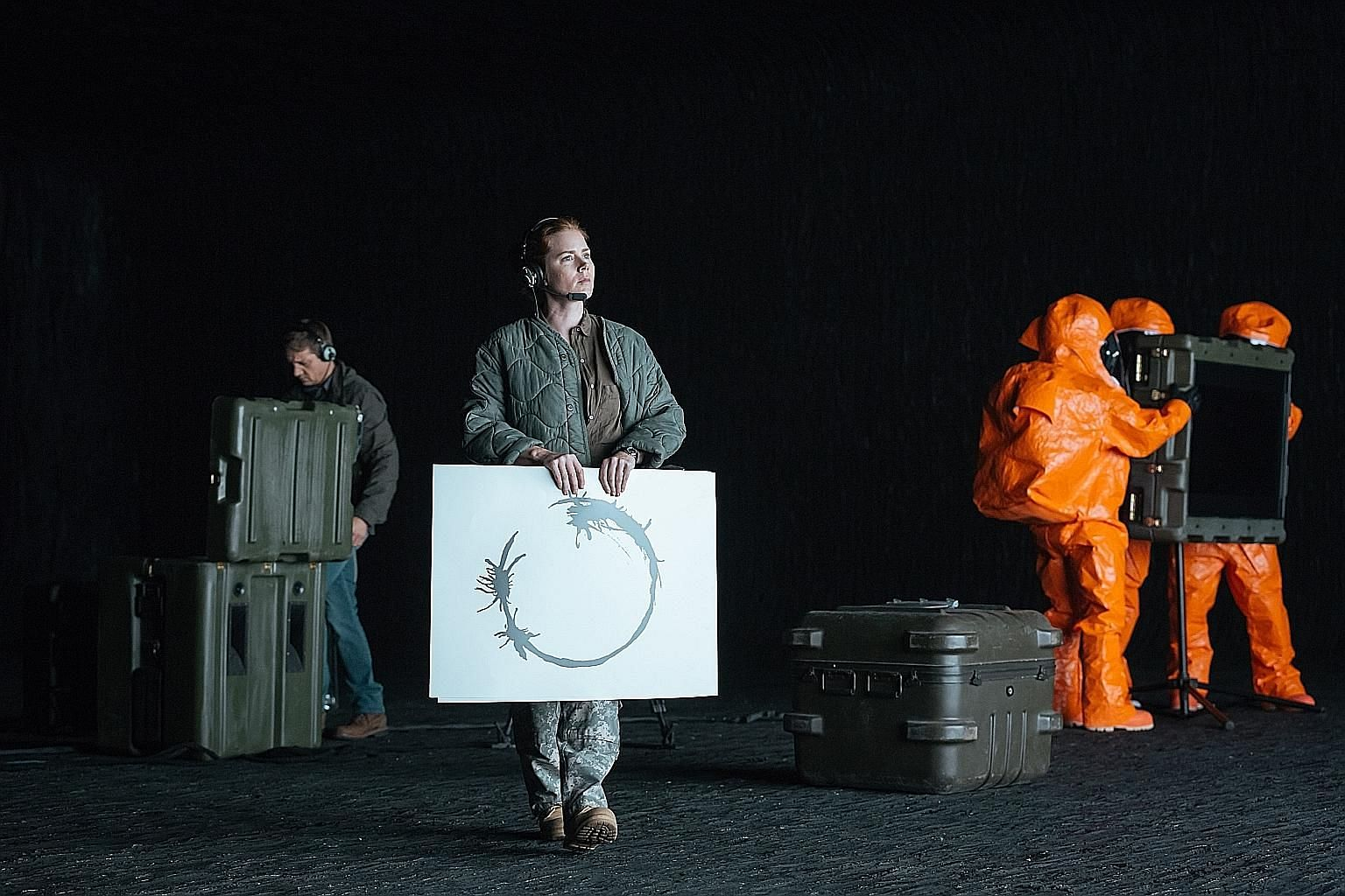 Amy Adams (above) is tasked to interpret the language of aliens in Arrival.