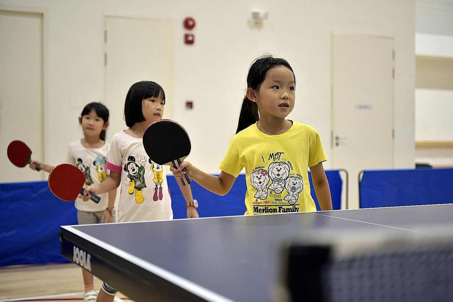 Top: Children at the Wang Yuegu Table Tennis Academy learning the proper way to grip a bat. Above: The 38-lane bowling alley at Temasek Club is where the national team train.