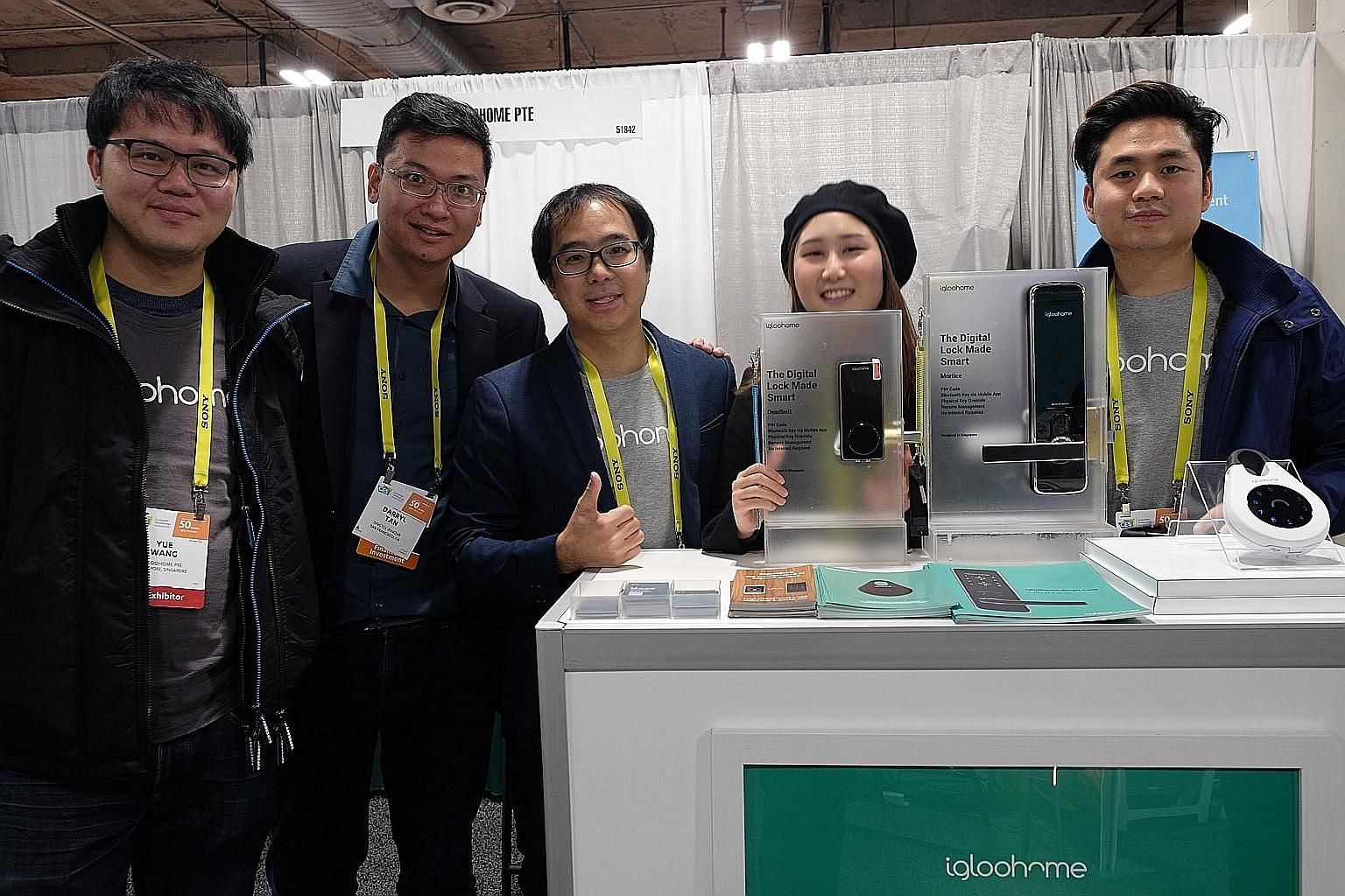 Mr Darryl Tan of Singtel Innov8 (second from left) with the team from igloohome (from left): COO and co-founder Yue Wang, Mr Chow, Ms Hara Ku and Mr Kenny Wang, sales and marketing director. Presenting the local start-up's Tiny1 astronomy camera at L