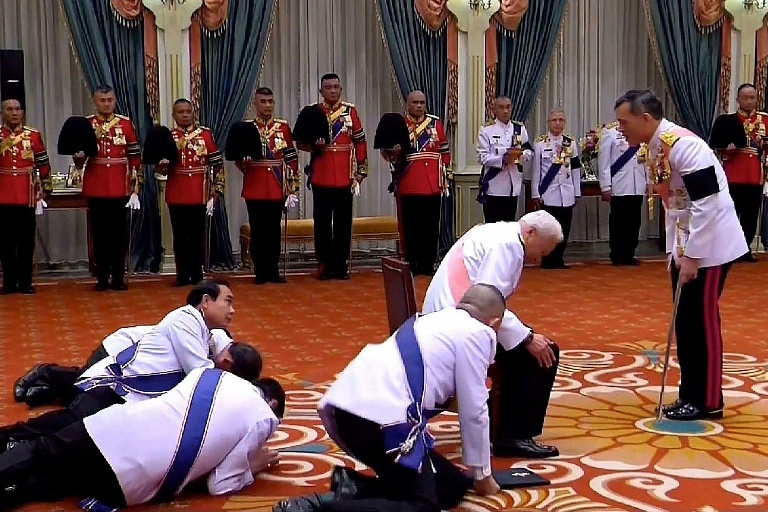 Prime Minister Prayut Chan-o-cha (in the back row, with head lifted) and Privy Council president Prem Tinsulanonda (with pink sash) prostrating before the newly appointed Thai King Maha Vajiralongkorn in Bangkok on Dec 1 last year, following the deat