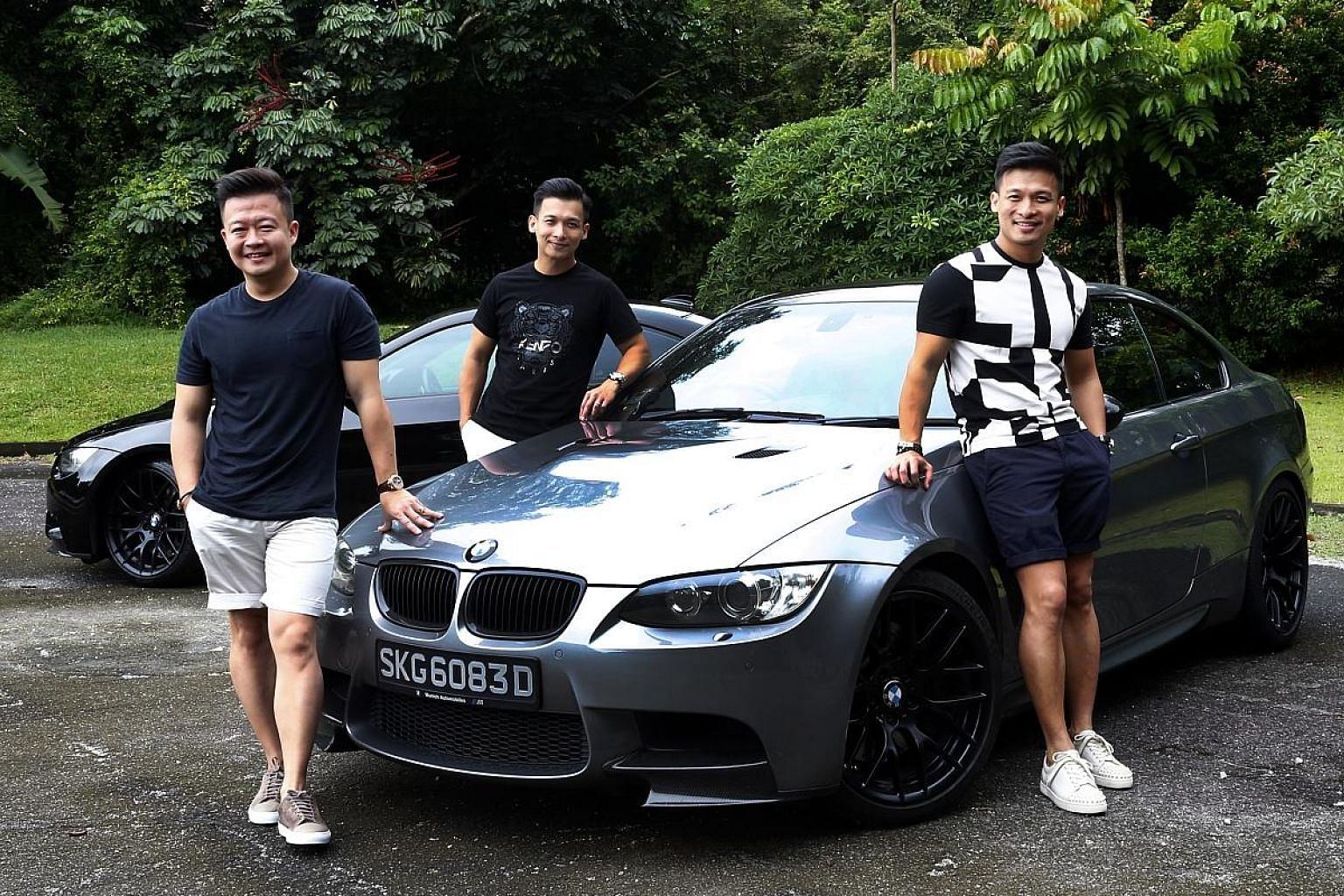 Amos's car boot. Brothers (from left) Amos Poh, Wen Yi and Adrel drive BMW M3 coupes. The grey M3 belongs to Amos and the one behind belongs to Wen Yi. Adrel drives a black M3, which was at the workshop on the day of the photoshoot.