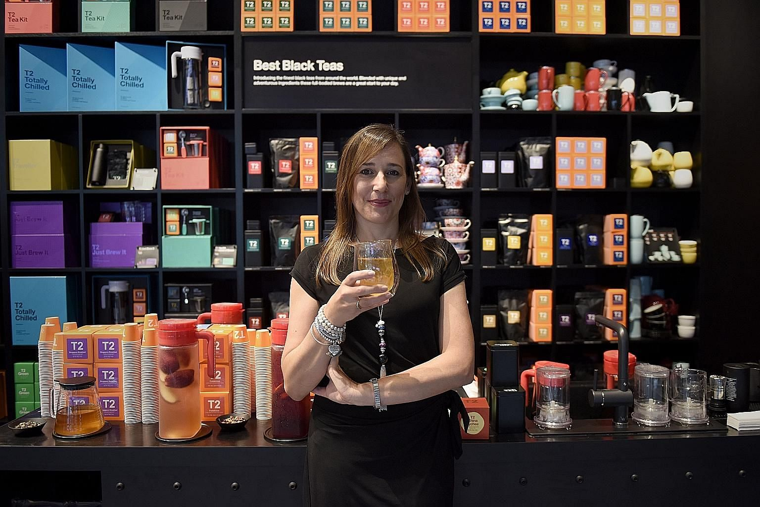 T2 chief executive officer Nicky Sparshott with the Singapore Breakfast tea, a blend of pu'er, green tea, coconut flakes and roasted rice.