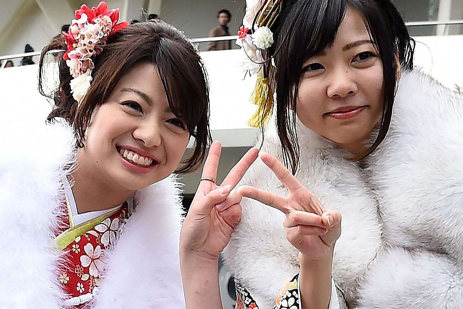 """Flashing the """"peace"""" sign in photos could lead to fingerprint data being stolen, according to Japan's National Institute of Informatics."""