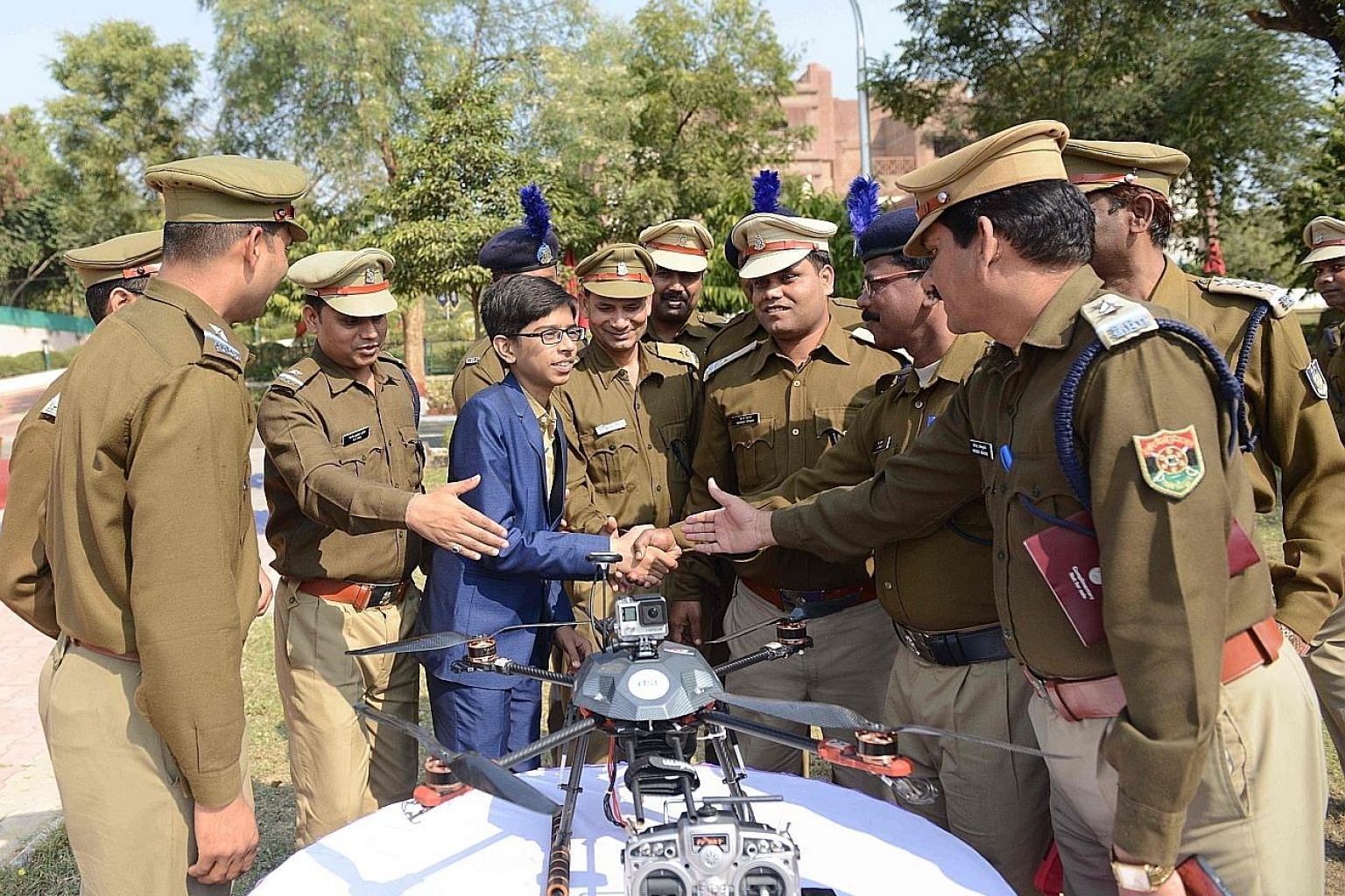 Indian student Harshwardhan Zala meeting Central Reserve Police Force officers to show them a drone he designed. The meeting took place at the Rapid Action Force Camp on the outskirts of Ahmedabad on Sunday. Zala began working on a prototype of the d