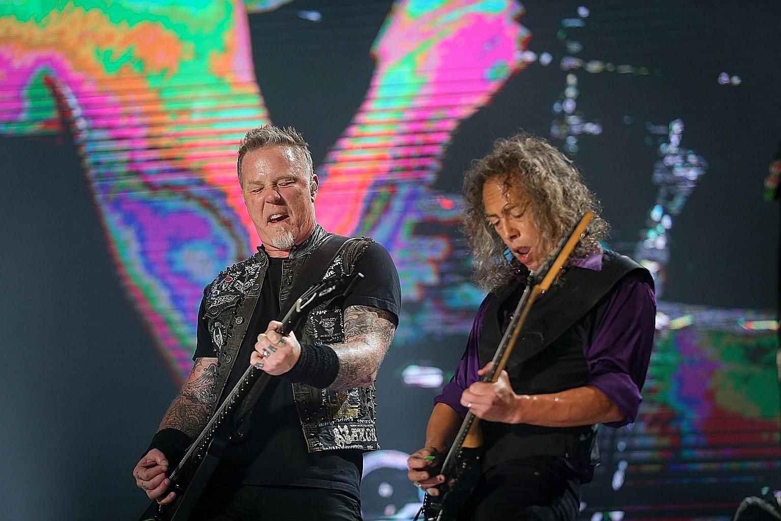 Metallica's James Hetfield (left) and Kirk Hammett (right) at the Singapore concert on Sunday.