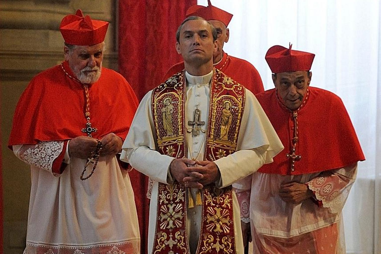 Jude Law (above) plays a Pope who seems to be part-Bond villain and part-saint in The Young Pope.