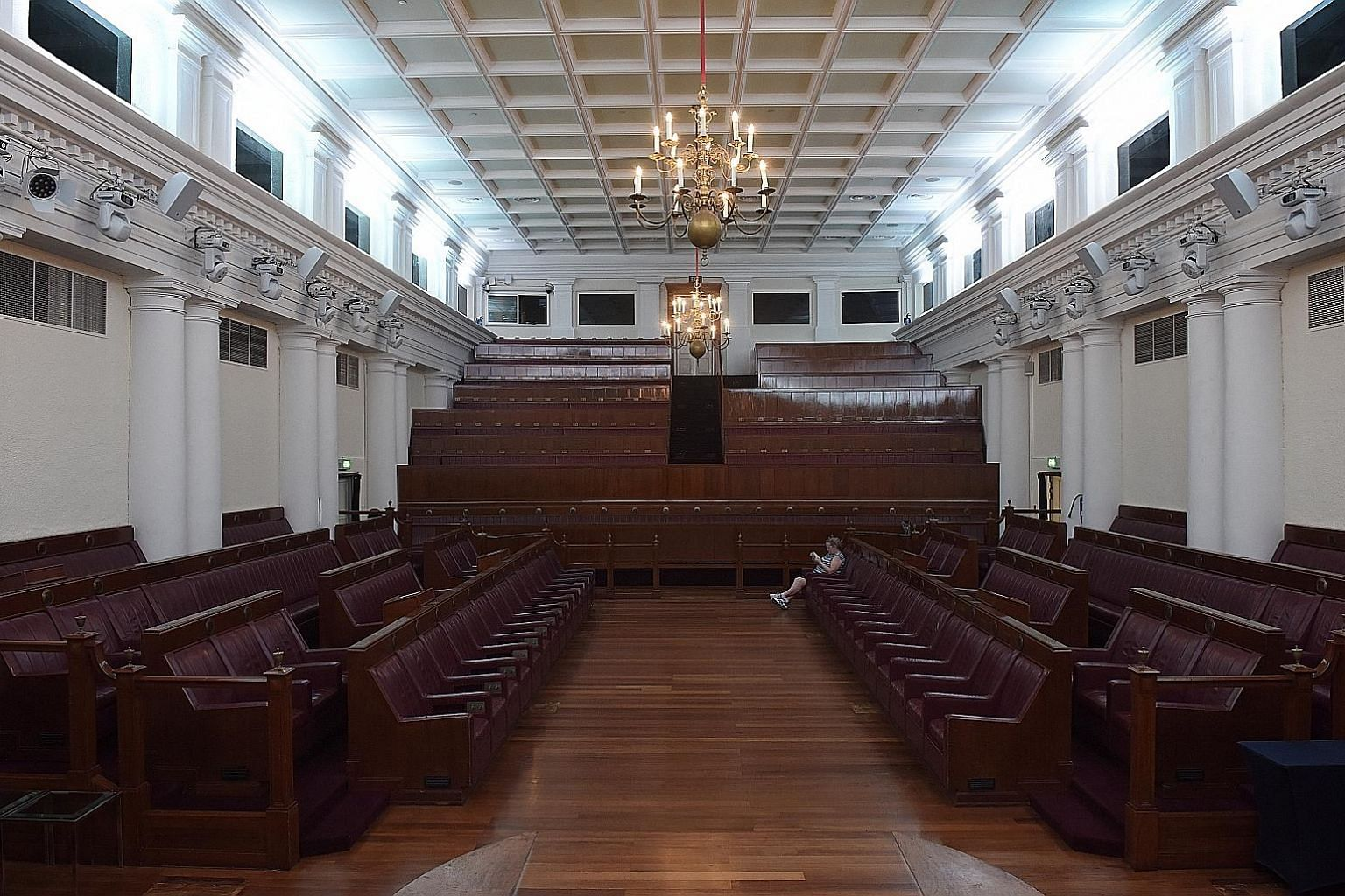 The Arts House (below), formerly Parliament House, is now an arts venue and a home for local voices, but the Chamber (left), where independent Singapore's formative laws were debated and passed, still retains its original custom-made furniture from L