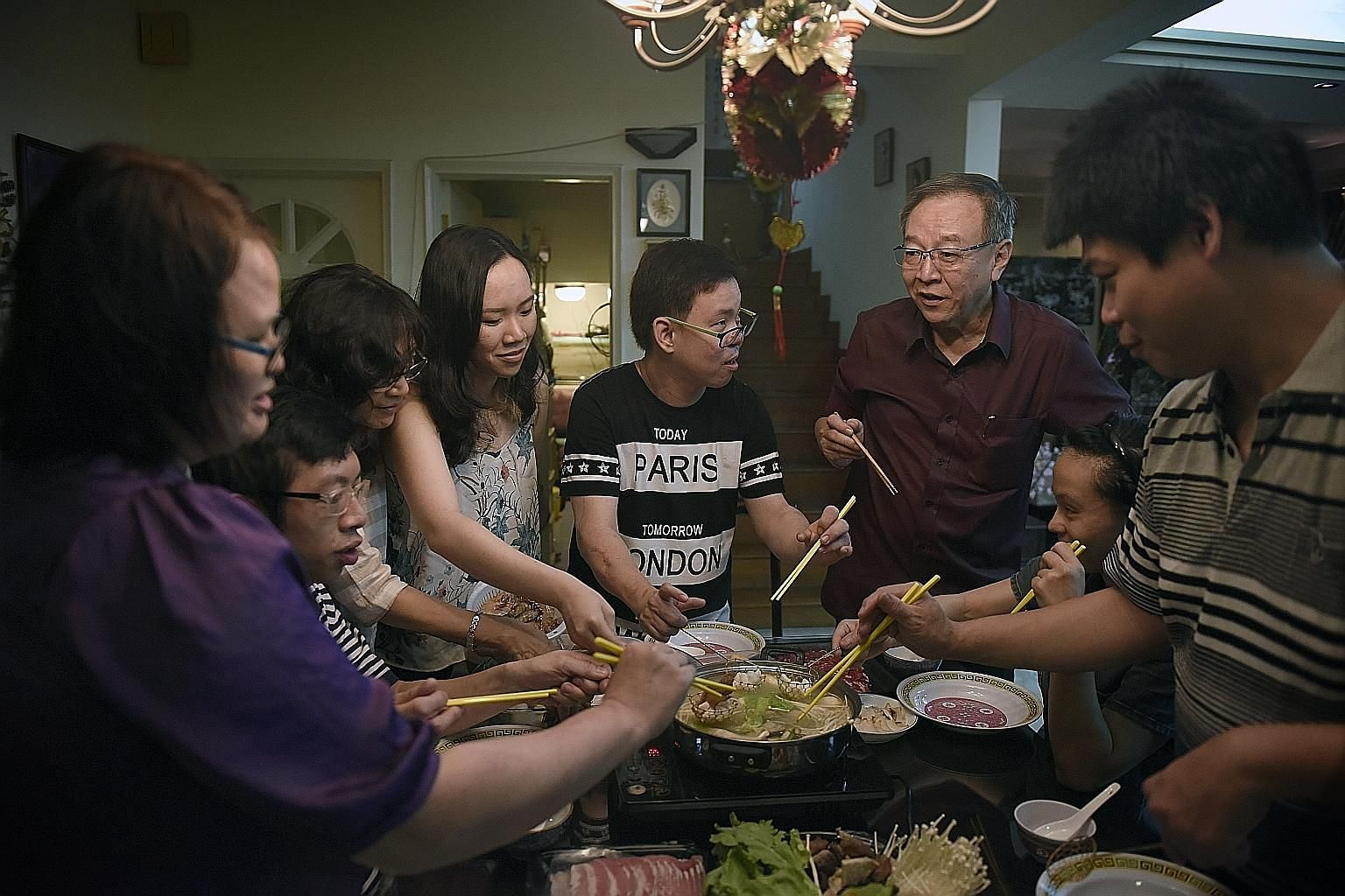 Mr Keh (in maroon shirt) at the reunion dinner with (from left) Ms Yap, Mr Low Boon Chin, Mr Keh's wife Geok Lian and daughter Yu Jia, Mr Tham, Ms Lim Bee Hong and Mr Benny Sun.