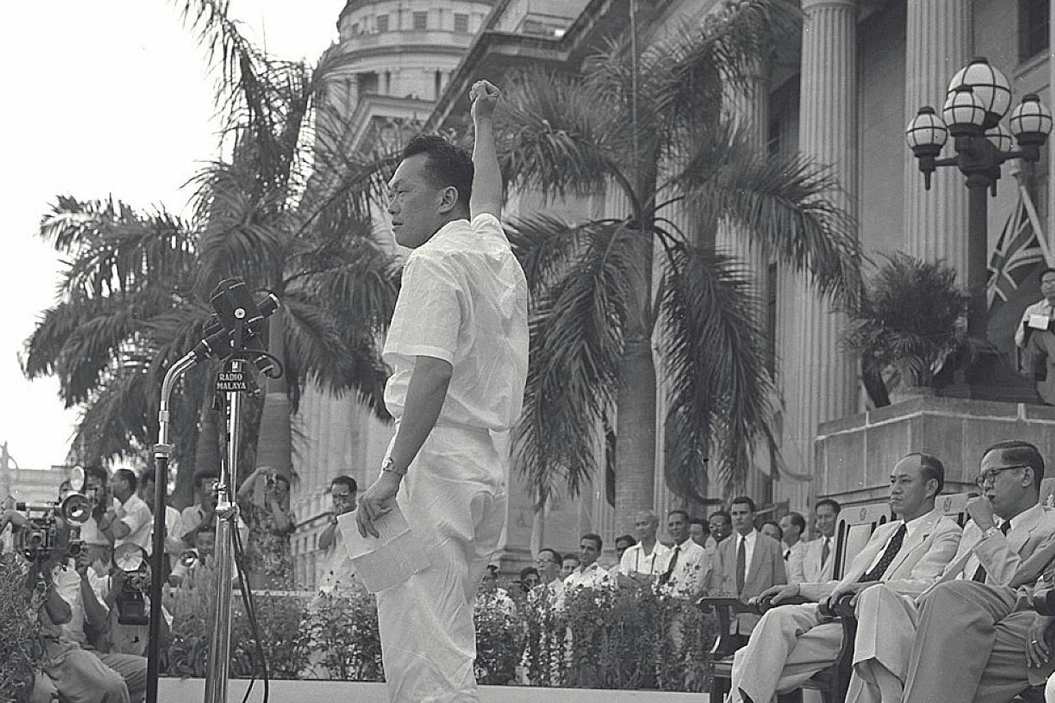Mr Lee giving a speech at the City Hall steps in April 1957. A source told the CIA that Mr Lee was considering leaving the PAP to start a new party with the Labour Front's Mr Lim (right).