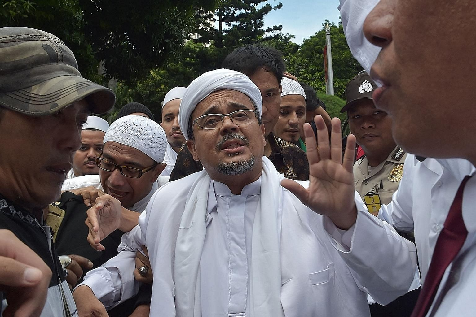 Mr Rizieq arriving at the Jakarta police headquarters on Jan 23. The Islamic Defenders' Front chairman had been jailed twice previously - in 2003 for inciting his followers to violently harass people at nightspots in Jakarta, and in 2008 for attackin