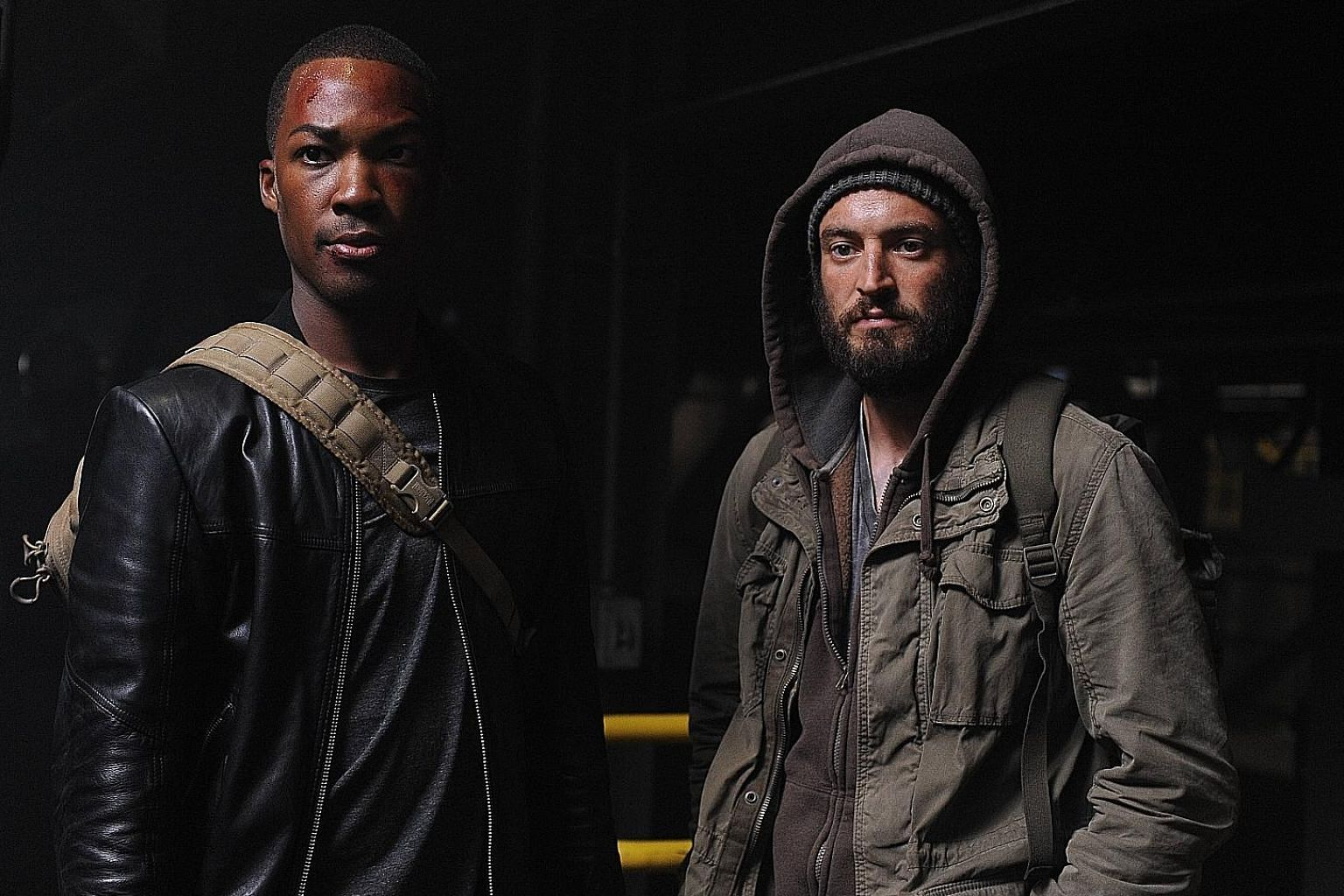 Corey Hawkins (far left, with actor Charlie Hofheimer) plays a former member of an elite Army Ranger squad in 24: Legacy.