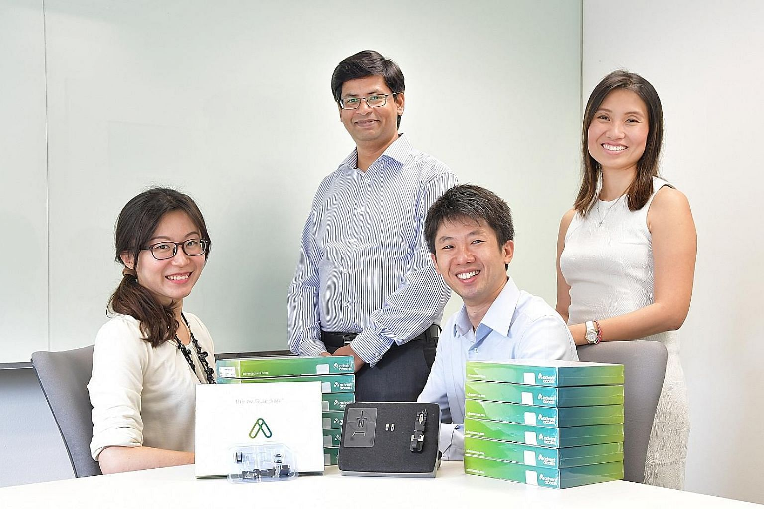 The Advent Access team comprises (from far left) R&D scientist Dr Ye Hongye; senior product engineer Henry Johnson; CEO and founder Peh Ruey Feng; and regulatory specialist Iris Tan.