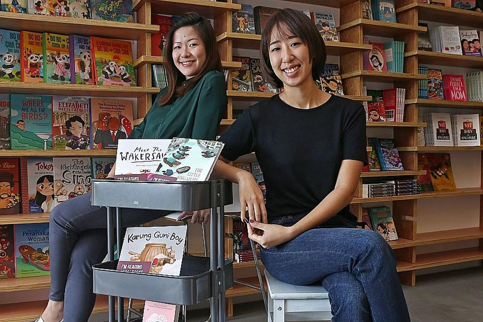 Localbooks.sg's co-founders Callie Chong (far left) and Julie Hyun.