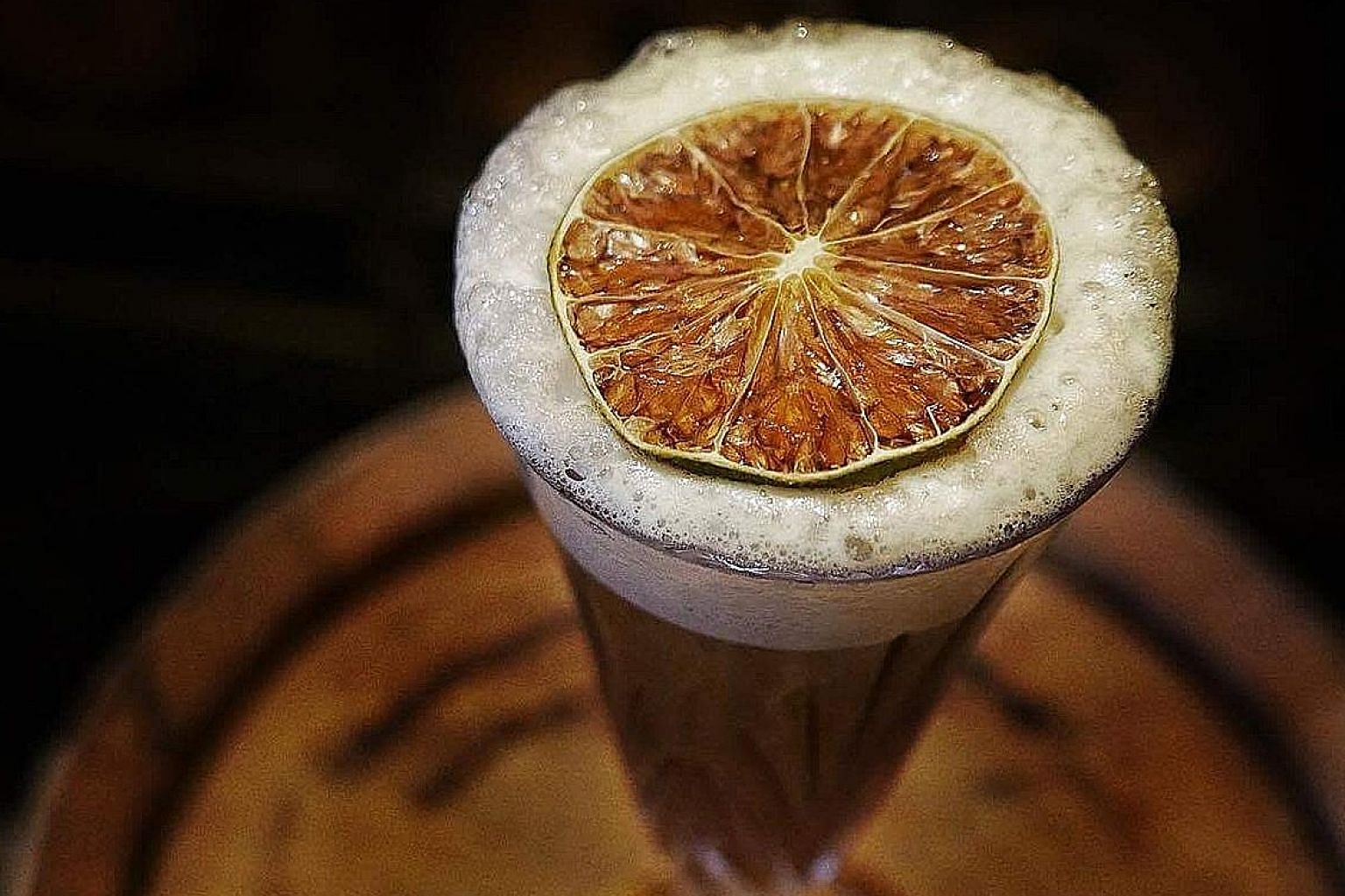 Manhattan's Aged Singapore Sling will be served at Raffles Hotel's Long Bar on Sunday.
