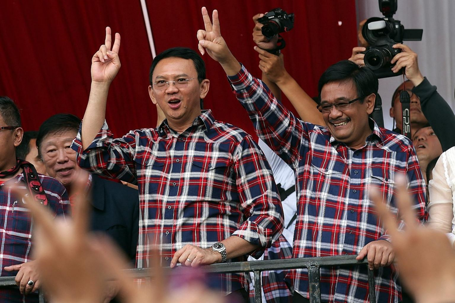 Mr Agus (far left), son of former president Yudhoyono, might be seen as a political novice by some, so choosing Ms Sylviana, a City Hall veteran, as his running mate might have been a move by the Democratic Party to counterbalance that perception. Mr