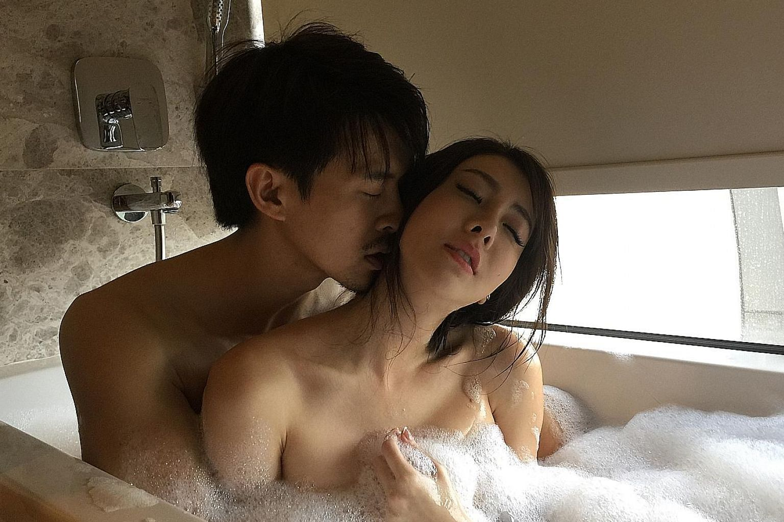 Louis Wu and Melody Low star in Singapore erotic film Siew Lup, which opens in cinemas here on Feb 23.