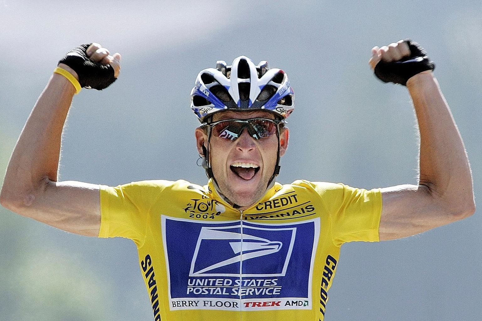 Lance Armstrong celebrating at the finishing line during the 2004 Tour de France. His seven Tour de France wins were voided for doping.