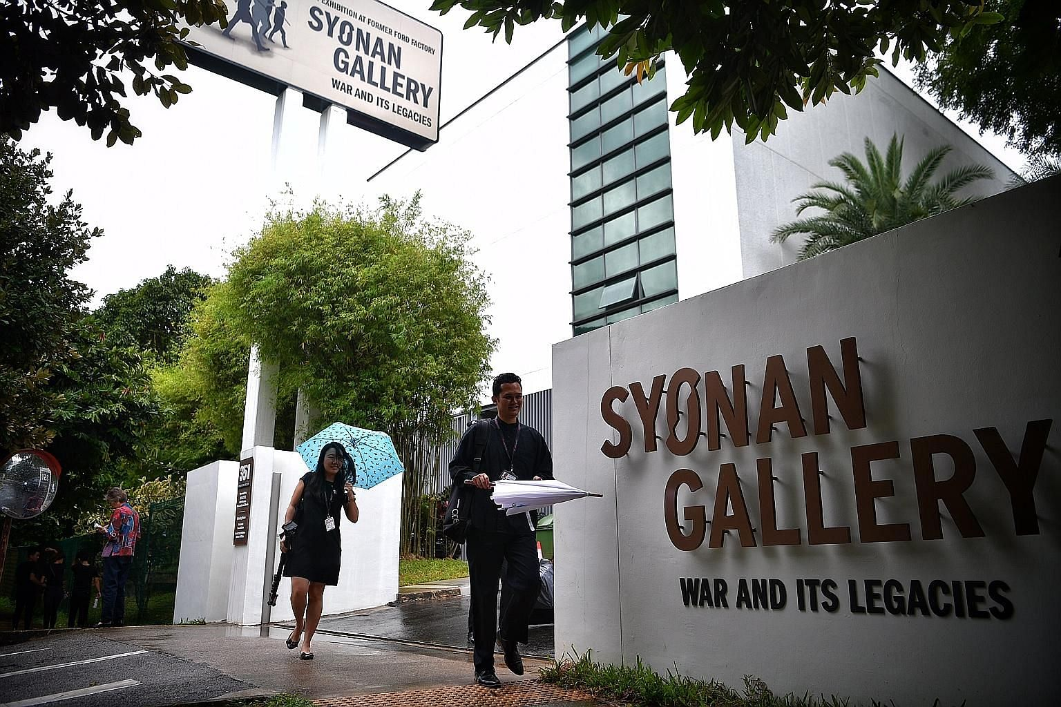 "(Above and left) Signs in front of the building and by the road now reflect the gallery's full name ""Syonan Gallery: War and Its Legacies"", and include the phrase ""An Exhibition at Former Ford Factory"". The name ""Syonan Gallery"" had upset some Singap"