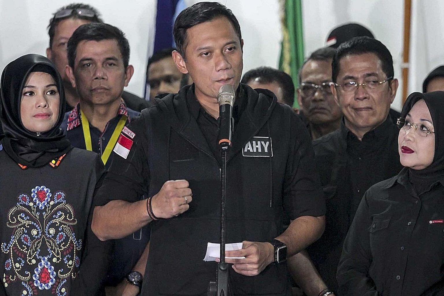 Mr Agus, flanked by his wife Annisa Pohan (left) and running mate Sylviana Murni, conceded defeat in the Jakarta election on Wednesday night. The voters who backed him will now be courted by the campaign teams of the remaining candidates, Basuki and
