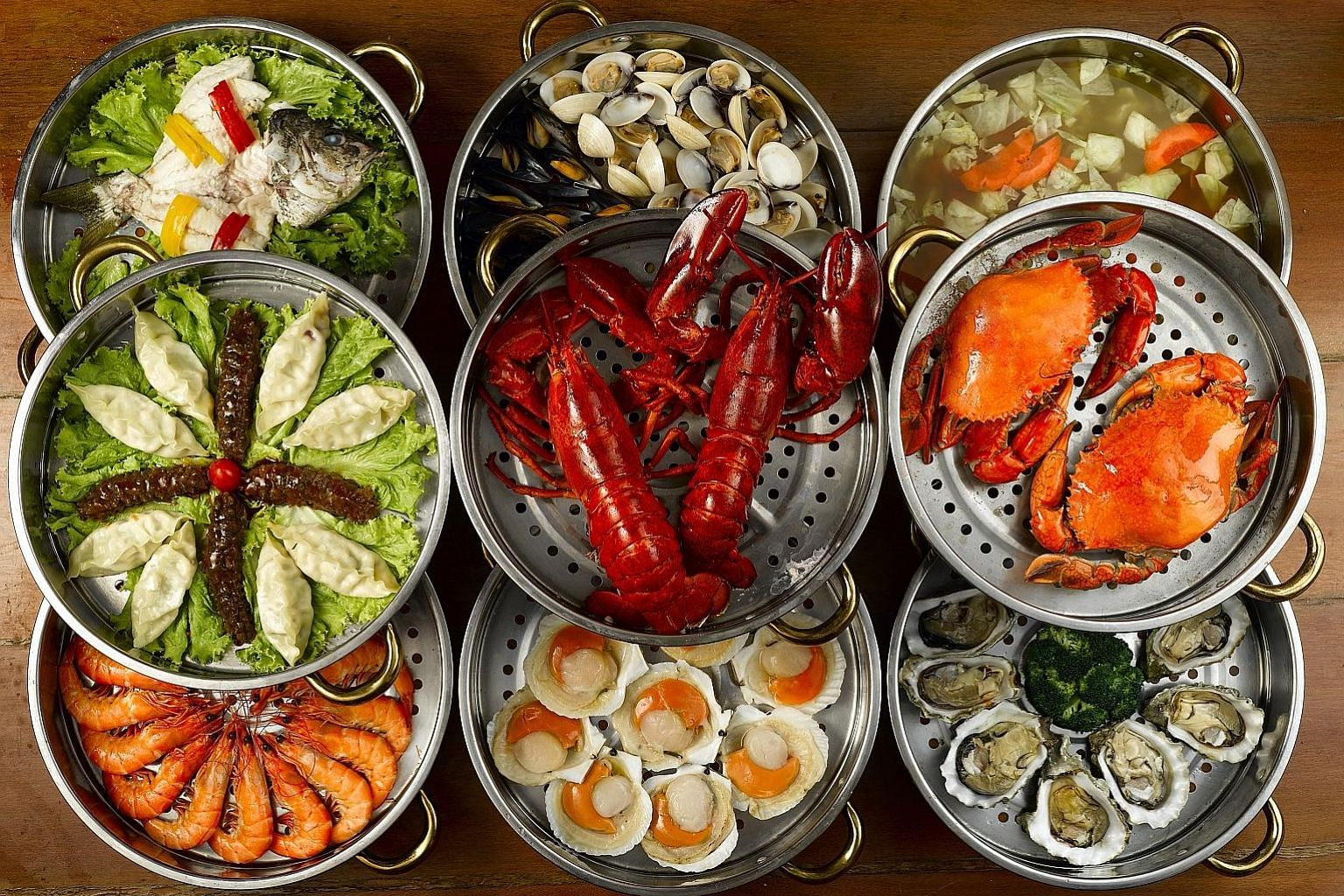 Seafood comes in tiers of three to nine steamers (left), with each tier holding different items (above) and a pot of broth at the bottom.