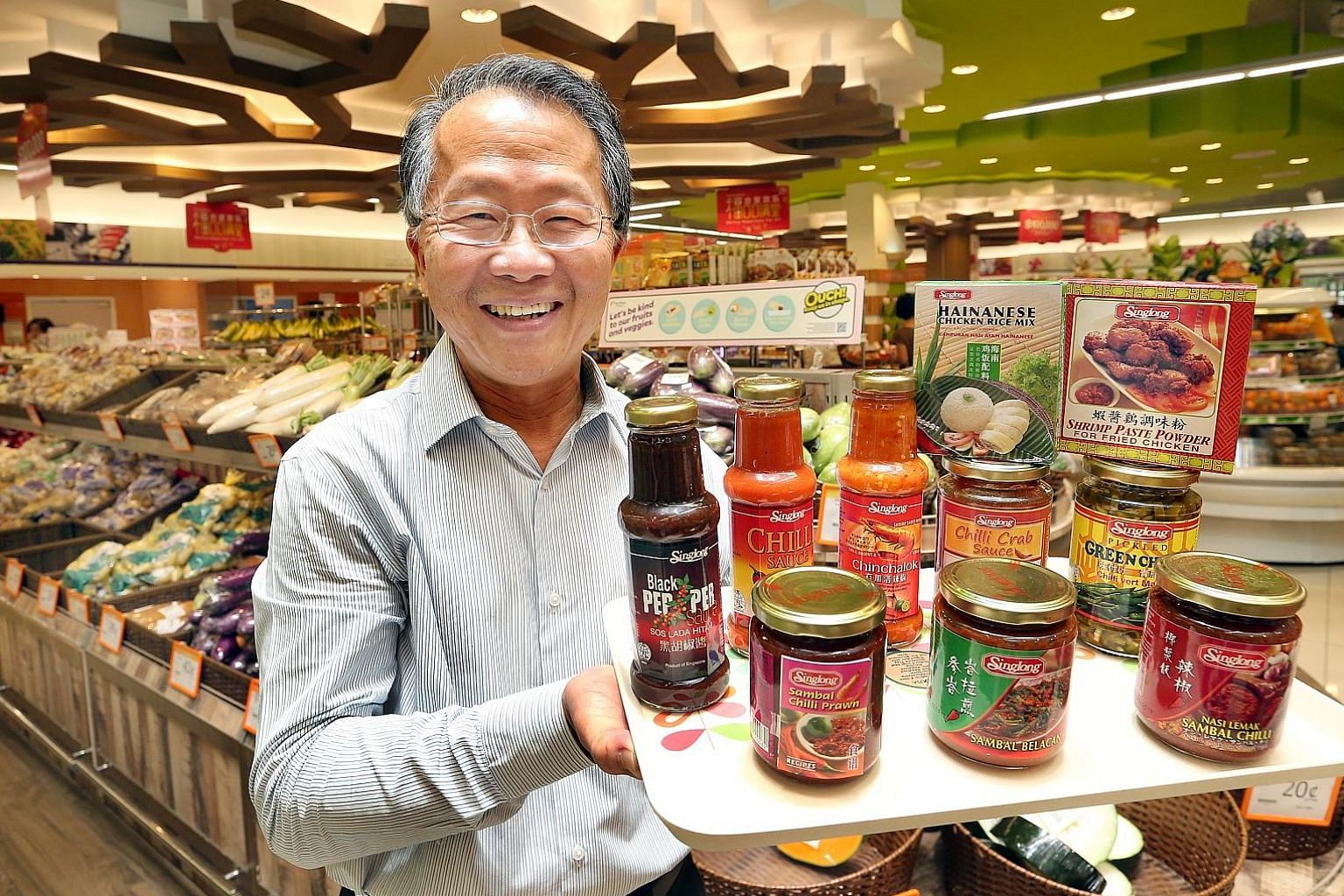 Sing Long managing director Ng Chin Nyan with products that he supplies to FairPrice. The scheme to help SMEs has reduced the need for the firm to take bank loans and this has helped it to save on interest costs.